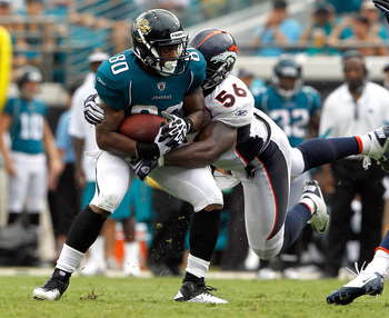 JACKSONVILLE, FL - SEPTEMBER 12:  Robert Ayers #56 of the Denver Broncos attempts to tackle Mike Thomas #80 of the Jacksonville Jaguars during the NFL season opener game at EverBank Field on September 12, 2010 in Jacksonville, Florida.  (Photo by Sam Gree