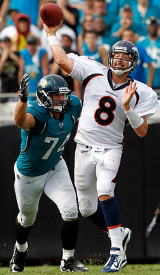 JACKSONVILLE, FL - SEPTEMBER 12:   Aaron Kampman #74 of the Jacksonville Jaguars pressure Kyle Orton #8 of the Denver Broncos during the NFL season opener game at EverBank Field on September 12, 2010 in Jacksonville, Florida.  (Photo by Sam Greenwood/Gett