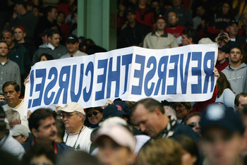 BOSTON - OCTOBER 5:  Boston Red Sox fans hold up a sign reading 'Reverse the Curse' during game four of the American League Division Series against the Oakland Athletics on October 5, 2003 at Fenway Park in Boston, Massachusetts.The Red Sox defeated the O