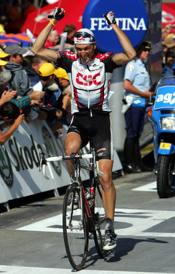 LA MONGIE, FRANCE- JULY 16: Ivan Basso of Italy of the CSC team celebrates as he wins Stage 12 of the Tour de France between Castelsarrasin and La Mongie on July 16, 2004 in La Mongie, France. (Photo by Robert Laberge/Getty Images)