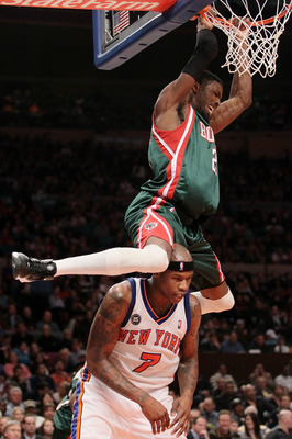 NEW YORK - FEBRUARY 05: Hakim Warrick #21 of the Milwaukee Bucks swings on the ring after dunking on Al Harrington #7 of the New York Knicks at Madison Square Garden February 5, 2010 in New York City. NOTE TO USER: User expressly acknowledges and agrees t