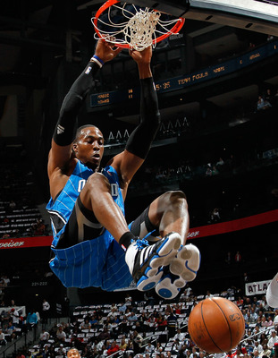 ATLANTA - MAY 10:  Dwight Howard #12 of the Orlando Magic dunks against the Atlanta Hawks during Game Four of the Eastern Conference Semifinals of the 2010 NBA Playoffs at Philips Arena on May 10, 2010 in Atlanta, Georgia.  NOTE TO USER: User expressly ac