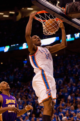 OKLAHOMA CITY - APRIL 22:  Kevin Durant #35 of the Oklahoma City Thunder dunks the ball against Ron Artest #37 of the Los Angeles Lakers during Game Three of the Western Conference Quarterfinals of the 2010 NBA Playoffs on April 22, 2010 at the Ford Cente