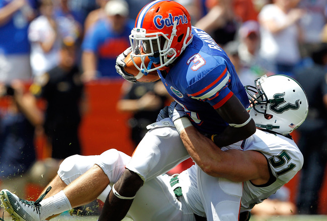 GAINESVILLE, FL - SEPTEMBER 11:  Chris Rainey #3 of the Florida Gators is tackled by Armando Sanchez #51 of the South Florida Bulls during a game at Ben Hill Griffin Stadium on September 11, 2010 in Gainesville, Florida.  (Photo by Sam Greenwood/Getty Ima