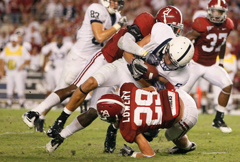 TUSCALOOSA, AL - SEPTEMBER 11:  Dre Kirkpatrick #21 and Will Lowery #29 of the Alabama Crimson Tide tackle Derek Moye #6 of the Penn State Nittany Lions at Bryant-Denny Stadium on September 11, 2010 in Tuscaloosa, Alabama.  (Photo by Kevin C. Cox/Getty Im