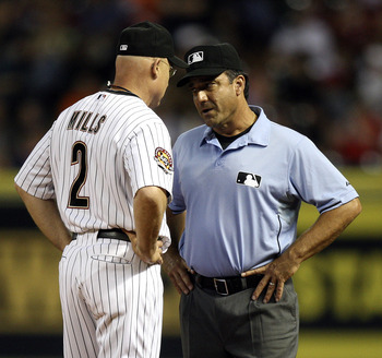 HOUSTON - JULY 30:  Houston Astros manager Brad Mills #2 has words with first base umpire Phil Cuzzi after calling Michael Bourn out on a close call at first base against the Milwaukee Brewers at Minute Maid Park on July 30, 2010 in Houston, Texas.  (Phot