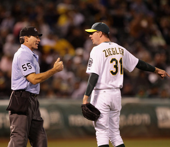 OAKLAND, CA - AUGUST 06:  Brad Ziegler #31 of the Oakland Athletics argues with home plate umpire Angel Hernandez after Henandez called Ziegler for a balk that scored Elvis Andrus #1 of the Texas Rangers to give the Rangers a 5-1 lead in the eighth inning