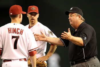 PHOENIX - JUNE 08:  First base umpire Joe West reacts to manager A.J. Hinch of the Arizona Diamondbacks during the Major League Baseball game against the Atlanta Braves at Chase Field on June 8, 2010 in Phoenix, Arizona.  (Photo by Christian Petersen/Gett