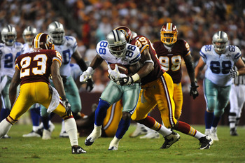 LANDOVER - SEPTEMBER 12:  Dez Bryant #88 of the Dallas Cowboys runs the ball during the NFL season opener against the Washington Redskins at FedExField on September 12, 2010 in Landover, Maryland. The Redskins defeated the Cowboys 13-7. (Photo by Larry Fr