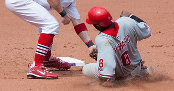ST. LOUIS - JULY 22: Brendan Ryan #13 of the St. Louis Cardinals tags out Ryan Howard #6 of the Philadelphia Phillies at Busch Stadium on July 22, 2010 in St. Louis, Missouri. The Phillies defeated the Cardinals 2-0.  (Photo by Dilip Vishwanat/Getty Image