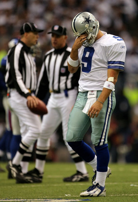 IRVING, TX - JANUARY 13:  Quarterback Tony Romo #9 of the Dallas Cowboys reacts after an intentional grounding penalty during the fourth quarter of the NFC Divisional Playoff game against the New York Giants at Texas Stadium on January 13, 2008 in Irving,