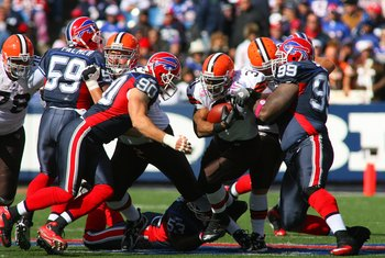 ORCHARD PARK, NY - OCTOBER 11:  Jamal Lewis #31 of the Cleveland Browns runs the ball against Marcus Stroud #99 and Chris Kelsay #90 of the Buffalo Bills during their NFL game at Ralph Wilson Stadium on October 11, 2009 in Orchard Park, New York. The Brow