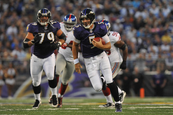 BALTIMORE - AUGUST 28:  Joe Flacco #5 of the Baltimore Ravens runs the ball against the New York Giants at M&T Bank Stadium on August 28, 2010 in Baltimore, Maryland. The Ravens lead the Giants 17-3. (Photo by Larry French/Getty Images)