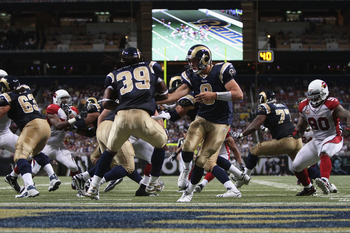 ST. LOUIS - SEPTEMBER 12: Sam Bradford #8 of the St. Louis Rams hands the ball off against the Arizona Cardinals during the NFL season opener at the Edward Jones Dome on September 12, 2010 in St. Louis, Missouri.  The Cardinals beat the Rams 17-13.  (Phot