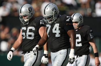 OAKLAND, CA - NOVEMBER 4: Cooper Carlisle #66, Cornell Green #74 and Josh McCown #12 of the Oakland Raiders leave the field against the Houston Texans at McAfee Coliseum November 4, 2007 in Oakland, California.  (Photo by Jed Jacobsohn/Getty Images)