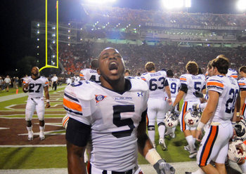 Mike Dyer celebrates after Auburn beat Mississippi State in Starkville Thursday night, 17-14. Photo courtesy of the Birmingham News.