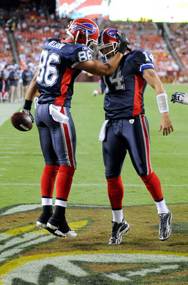 LANDOVER, MD - AUGUST 13:  David Nelson #86 celebrates with Ryan Fitzpatrick #14 of the Buffalo Bills after scoring in the third quarter of the preseason game against the Washington Redskins at FedEx Field on August 13, 2010 in Landover, Maryland.  (Photo