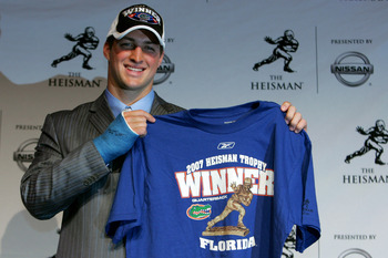 NEW YORK - DECEMBER 08:  Quarterback Tim Tebow of the University of Florida holds up a winners shirt after winning the 73rd Annual Heisman Memorial Trophy Award on December 8, 2007 in New York City.  (Photo by Chris Trotman/Getty Images)