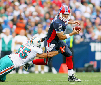 ORCHARD PARK, NY - SEPTEMBER 12:  Trent Edwards #5 the Buffalo Bills is sacked by Koa Misi #55 of the Miami Dolphins during the NFL season opener at Ralph Wilson Stadium on September 12, 2010 in Orchard Park, New York. Miami won 15-10. (Photo by Rick Stew