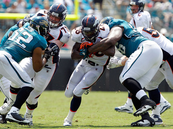 JACKSONVILLE, FL - SEPTEMBER 12:  Terrance Knighton #96 of the Jacksonville Jaguars attempts to tackle Correll Buckhalter #28 of the Denver Broncos during the NFL season opener game at EverBank Field on September 12, 2010 in Jacksonville, Florida.  (Photo