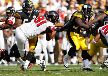 PITTSBURGH - SEPTEMBER 12:  Rashard Mendenhall #34 of the Pittsburgh Steelers tries to run out of the grasp of Corey Peters #91 of the Atlanta Falcons during the NFL season opener game on September 12, 2010 at Heinz Field in Pittsburgh, Pennsylvania.  (Ph
