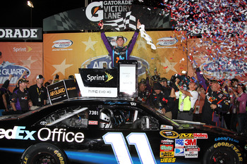 RICHMOND, VA - SEPTEMBER 11:  Denny Hamlin, driver of the #11 FedEx Office Toyota, celebrates in Victory Lane after winning the NASCAR Sprint Cup Series Air Guard 400 at Richmond International Raceway on September 11, 2010 in Richmond, Virginia.  (Photo b