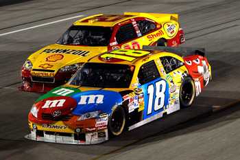 RICHMOND, VA - SEPTEMBER 11:  Kyle Busch, driver of the #18 M&M's Toyota, races Kevin Harvick, driver of the #29 Shell/Pennzoil Chevrolet, during the NASCAR Sprint Cup Series Air Guard 400 at Richmond International Raceway on September 11, 2010 in Richmon