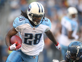 SEATTLE - AUGUST 14: Running back Chris Johnson #28 of the Tennessee Titans rushes against Aaron Curry #59 during the preseason game against the Seattle Seahawks at Qwest Field on August 14, 2010 in Seattle, Washington. (Photo by Otto Greule Jr/Getty Imag