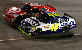 RICHMOND, VA - SEPTEMBER 11:  Jimmie Johnson, driver of the #48 Lowe's Chevrolet, races with Juan Pablo Montoya, driver of the #42 Target Chevrolet during the NASCAR Sprint Cup Series Air Guard 400 at Richmond International Raceway on September 11, 2010 i