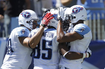 NASHVILLE - SEPTEMBER 12: Nate Washington #85 of the Tennessee Titans celebrates his touchdown catch with Bo Scaife #80 and Justin Gage #12 against the Oakland Raiders during the NFL season opener at LP Field on September 12, 2010 in Nashville, Tennessee.