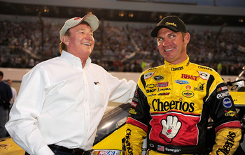 RICHMOND, VA - SEPTEMBER 11: Team owner Richard Childress (L) speaks with Clint Bowyer, driver of the #33 Cheerio's Chevrolet, prior to the start of the NASCAR Sprint Cup Series Air Guard 400 at Richmond International Raceway on September 11, 2010 in Rich