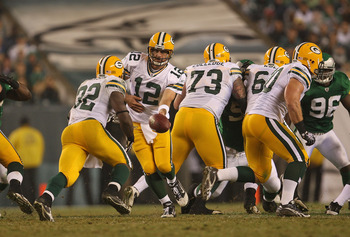 PHILADELPHIA - SEPTEMBER 12:  Aaron Rodgers #12 of the Green Bay Packers hands the ball off to Brandon Jackson #32 during a game against the Philadelphia Eagles at Lincoln Financial Field on September 12, 2010 in Philadelphia, Pennsylvania.  (Photo by Mik