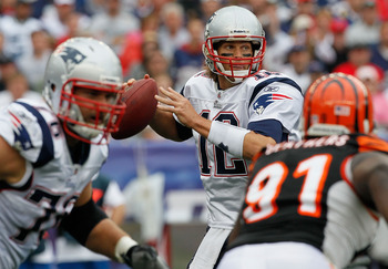 FOXBORO, MA - SEPTEMBER 12: Quarterbacks Tom Brady #12 of the New England Patriots throws a pass during a the NFL season opener against the Cincinnati Bengals at Gillette Stadium on September 12, 2010 in Foxboro, Massachusetts. (Photo by Jim Rogash/Getty