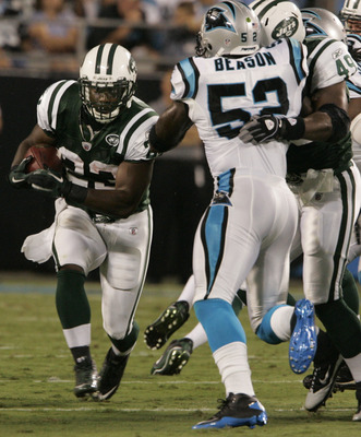 CHARLOTTE,NC - AUGUST 21:  Shonn Greene #23 of the New York Jets runs with the ball as Tony Richardson #49 holds off Jan Beason #52 of the Carolina Panthers during a preseason game at Bank of America Stadium on August 21, 2010 in Charlotte, North Carolina