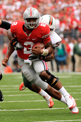 COLUMBUS, OH - SEPTEMBER 11:  Quarterback Terrelle Pryor #2 of the Ohio State Buckeyes is tackled by Marcus Robinson #56 of the Miami Hurricanes at Ohio Stadium on September 11, 2010 in Columbus, Ohio.  (Photo by Jamie Sabau/Getty Images)