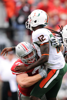 COLUMBUS, OH - SEPTEMBER 11:  Dexter Larimore #72 of the Ohio State Buckeyes hits quarterback Jacory Harris #12 of the Miami Hurricanes at Ohio Stadium on September 11, 2010 in Columbus, Ohio.  (Photo by Jamie Sabau/Getty Images)