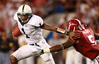 TUSCALOOSA, AL - SEPTEMBER 11:  Quarterback Robert Bolden #1 of the Penn State Nittany Lions stiff arms Jerrell Harris #5 of the Alabama Crimson Tide at Bryant-Denny Stadium on September 11, 2010 in Tuscaloosa, Alabama.  (Photo by Kevin C. Cox/Getty Image
