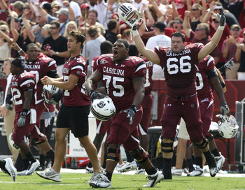 COLUMBIA, SC - SEPTEMBER 11: Members of the South Carolina Gamecocks team, including guard Steven Singleton #75 and tacklet Hutch Eckerson #66, run on the field after the game against the Georgia Bulldogs at Williams-Brice Stadium on September 11, 2010 in