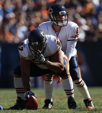 CHICAGO - SEPTEMBER 12: Jay Cutler #6 of the Chicago Bears calls play signals as teammate Olin Kreutz #57 prepares to snap the ball against the Detroit Lions during the NFL season opening game at Soldier Field on September 12, 2010 in Chicago, Illinois. T