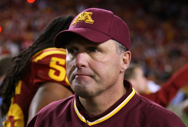 TEMPE, AZ - DECEMBER 31:  Head coach Tim Brewster of the Minnesota Golden Gophers walks off the field after being defeated by the Iowa State Cyclones in the Insight Bowl at Arizona Stadium on December 31, 2009 in Tempe, Arizona. The Cyclones defeated the 