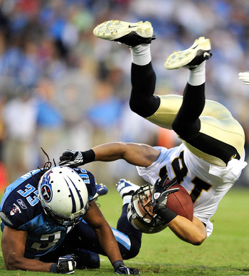 NASHVILLE, TN - SEPTEMBER 02:  Michael Griffin #33 of the Tennessee Titans upends Lance Moore #16 of the New Orleans Saints during an exhibition game at LP Field on September 2, 2010 in Nashville, Tennessee.  (Photo by Grant Halverson/Getty Images)