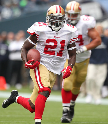 SEATTLE - SEPTEMBER 12:  Running back Frank Gore #21 of the San Francisco 49ers rushes during the NFL season opener against the Seattle Seahawks at Qwest Field on September 12, 2010 in Seattle, Washington. The Seahawks defeated the 49ers 31-6. (Photo by O