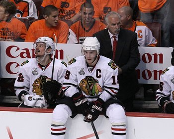 PHILADELPHIA - JUNE 09:  Head coach Joel Quenneville and Jonathan Toews #19 of the Chicago Blackhawks look on from the bench in Game Six of the 2010 NHL Stanley Cup Final against the Philadelphia Flyers at the Wachovia Center on June 9, 2010 in Philadelph