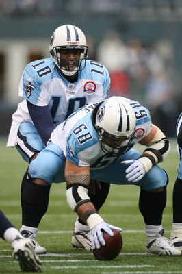 SEATTLE - JANUARY 03:  Vince Young #10 of the Tennessee Titans stands under center Kevin Mawae #68 during the game against the Seattle Seahawks on January 3, 2010 at Qwest Field in Seattle, Washington. (Photo by Otto Greule Jr/Getty Images)