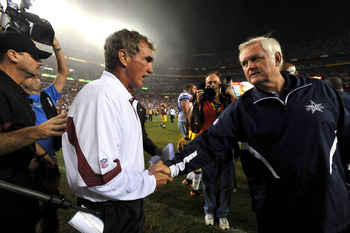 LANDOVER - SEPTEMBER 12:  Head coach Mike Shanahan of the Washington Redskins shakes hands with head coach Wade Phillips of the Dallas Cowboys after the NFL season opener against the Dallas Cowboys at FedExField on September 12, 2010 in Landover, Maryland