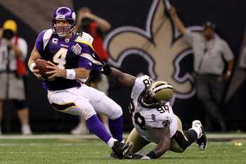 NEW ORLEANS - SEPTEMBER 09:  Sedrick Ellis #98 of the New Orleans Saints pulls down Brett Favre #4 of the Minnesota Vikings at Louisiana Superdome on September 9, 2010 in New Orleans, Louisiana. The Saints won 14-9. (Photo by Ronald Martinez/Getty Images)