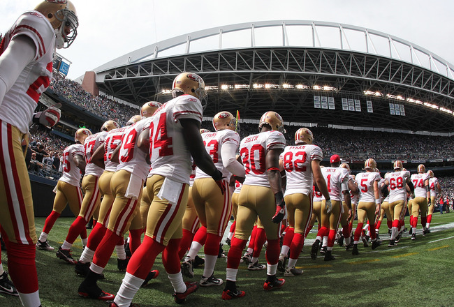 SEATTLE - SEPTEMBER 12:  Members of the San Francisco 49ers take the field prior to the NFL season opener against the Seattle Seahawks at Qwest Field on September 12, 2010 in Seattle, Washington. The Seahawks defeated the 49ers 31-6. (Photo by Otto Greule