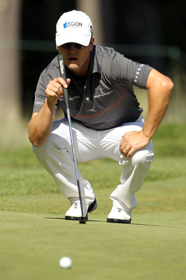 NORTON, MA - SEPTEMBER 05:  Zach Johnson lines up a putt on the 11th hole during the third round of the Deutsche Bank Championship at TPC Boston on September 5, 2010 in Norton, Massachusetts.  (Photo by Mike Ehrmann/Getty Images)