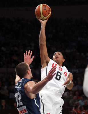 NEW YORK - AUGUST 15:  Derrick Rose #6 of the United States shoots over Nando De Colo #12 of France during their exhibition game as part of the World Basketball Festival at Madison Square Garden on August 15, 2010 in New York City.  (Photo by Nick Laham/G