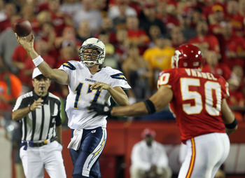 San Diego Chargers quarterback Philip Rivers firing a pass downfield while being persued by Kansas City Chiefs linebacker Mike Vrabel